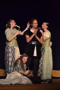 Matthew Lamb (center) as Gaston with Compton Little, Brooke Nixon, and Lillian Stoneberger as The Silly Girls