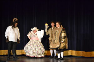 (L to R) Michael Livingston as Beast, Melissa Valdivia as Mrs. Potts, Jack Merson as Lumiere, and Ethan Brown as Cogsworth