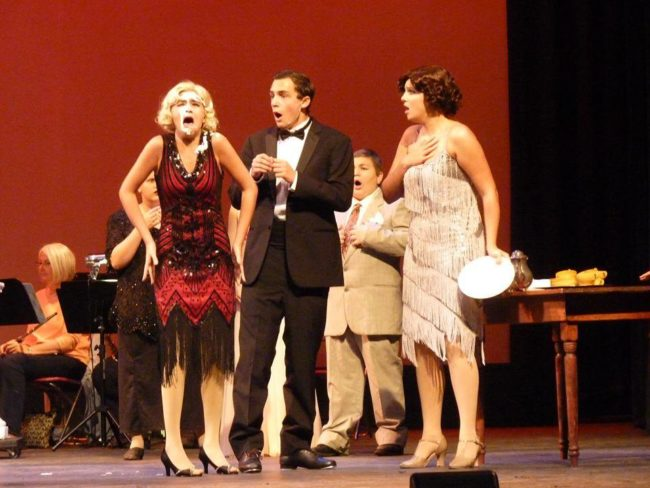 Olivia Aubele (left) as Lina Lamont, Kevin Franiak (center) as Don Lockwood and Rachel Miller (right) as Kathy Selden in Singin' in the Rain Jr.