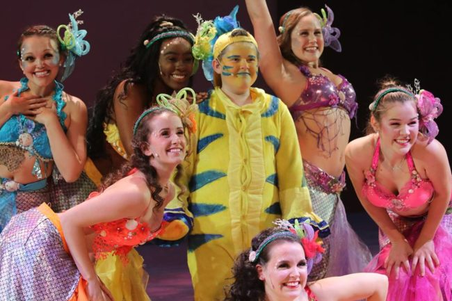 Daniel Koncurat (center) as Flounder and The Mersisters of The Little Mermaid