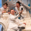 Tom Story (God), Jamie Smithson (Gabriel) and Evan Casey (Michael) in An Act of God at Signature Theatre.