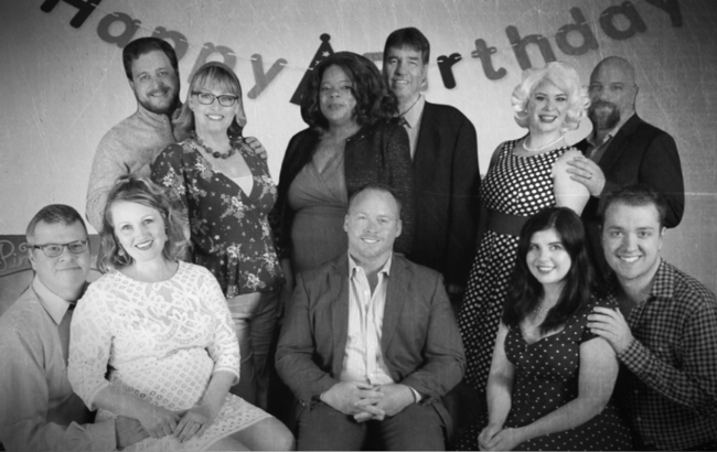 Rob Wall (center) as Bobby with the Husbands and Wives of Company