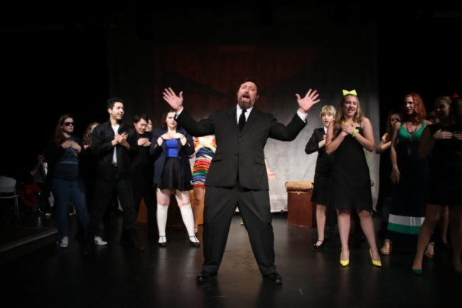 Jim Gross (center) as Ram's Dad and the ensemble of Heathers: The Musical
