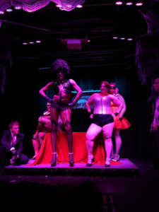 Diamond Taylor (left-center) as Dr. Frank N. Furter and Tapitha Kix (right-center) as Columbia