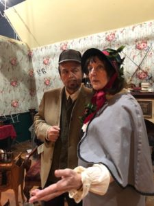 Chuck Dick (left) as Sherlock Holmes and Heidi Sue Toll (right) as First Spirit of Christmas Past