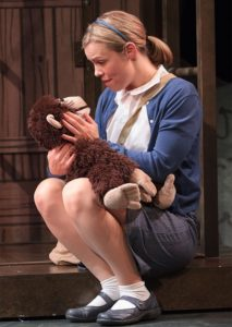 Erin Weaver as Young Jane holding Jubilee the Chimpanzee