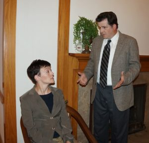 Jenn Mikulski (left) as Ms. Casewell and Brett Rohrer (right) as Det. Sgt. Trotter