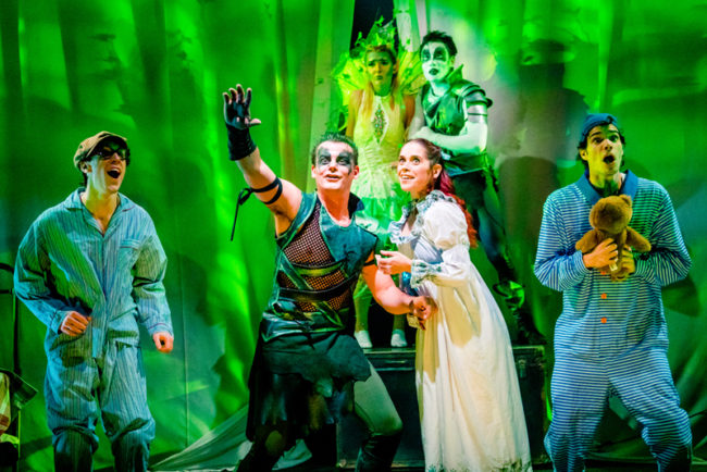 Alex Mills (center left) as Peter Pan and Kathy Gordon (center right) as Wendy Darling