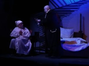 Richard Peck (left) as Ebenezer Scrooge and Thom Platt (right) as The Ghost of Jacob Marley