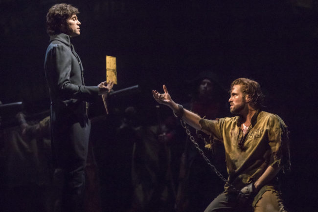 Josh Davis (left) as Javert and Nick Cartell (right) as Jean Valjean in  Les Misérables