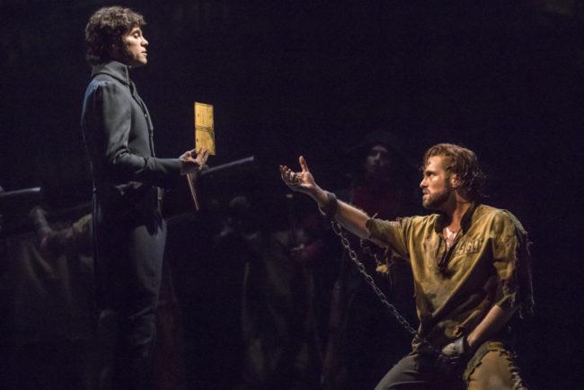 Josh Davis (left) as Javert and Nick Cartell (right) as Jean Valjean in  Les Misérables