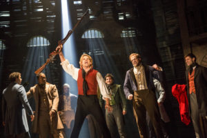 Matt Shingledecker as Enjolres with the cast of the National Tour of Les Misérables