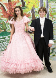 Olivia Lockett (left) as Isabelle and Gregory Areford (right) as Young Ebenezer