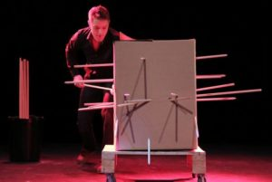 """Sam Strange performing the infamous """"Cardboard Box"""" illusion with Richard Young inside the box"""