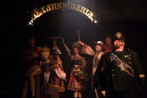 David Bosley-Reynolds (right) as Inspector Kemp and the Villagers of Transylvania