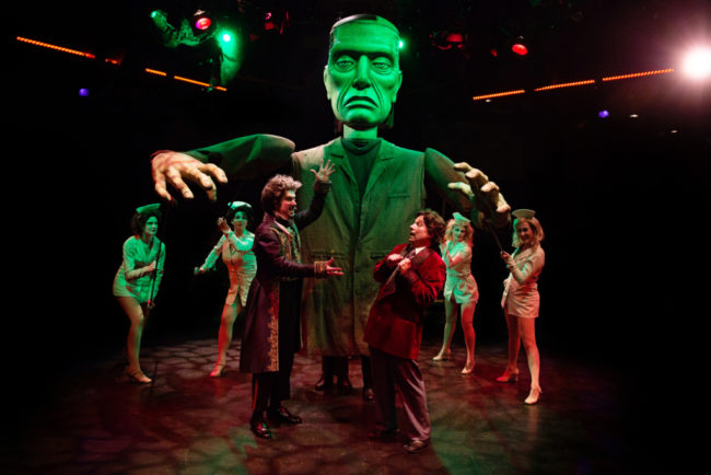Justin Calhoun (center left) as Victor Frankenstein with Jeffrey Shankle (center right) as Dr. Frederick Frankenstein and the Lab Babes