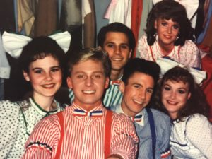 Jeffrey Shankle (front, center) as Tommy Djilas with Mark Minnick (back, center) and David James (right, center) as dancing boys in The Music Man at Burn Brae Dinner Theatre some time ago