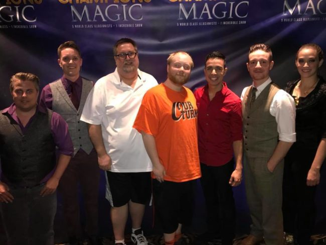 Reviewer Mike Zelhoffer (center left) and son William Zelhoffer (center right) with the magicians of Champions of Magic
