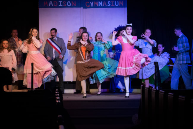 Grace Volpe (center left) and Olivia Winter (center right) sharing the role of Zaneeta in The Music Man