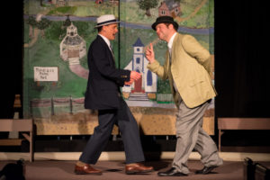 Joe Weinhoffer (left) as Harold Hill and Andrew Pedrick (right) as Marcellus Washburn in The Music Man