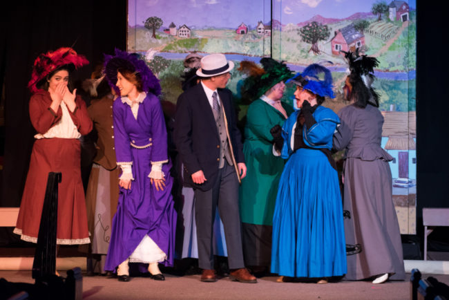 Joe Weinhoffer (center) as Harold Hill and the Ladies of River City, Iowa