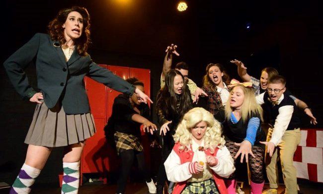 Lizzie Detar (left) as Heather Duke, Emily Elborn (right) as Heather McNamara, and ensemble