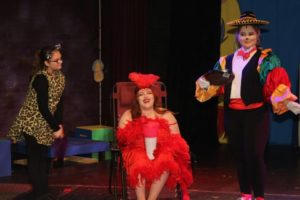 Abby Koncurat (center) as Mayzie LaBird