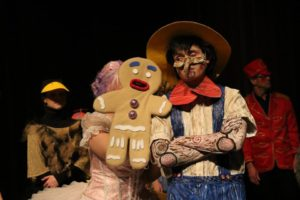 Christina Napp (left) as Gingy and Angel Duque (right) as Pinocchio in Shrek at CCP