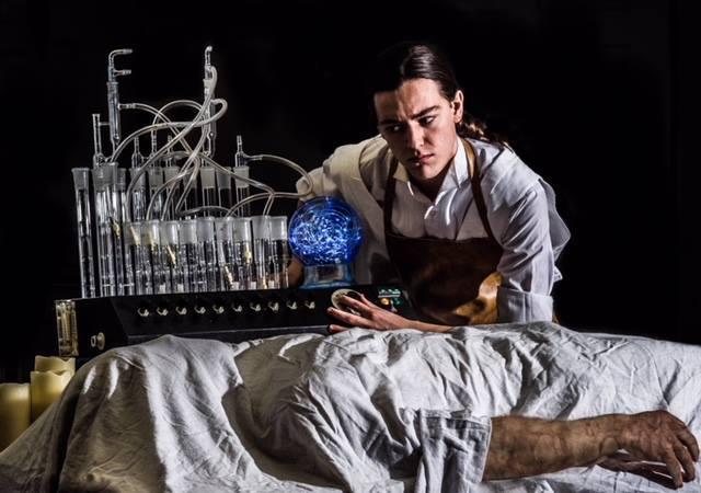Victor Frankenstein (Michael Bannigan) creating the creation (Tennyson Harris).