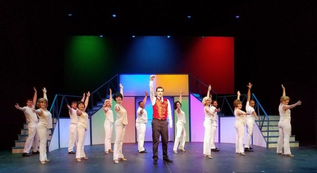 "Jim Baxter (center) as Frank Abagnale Jr. with the Frank Abagnale Jr. dancers for ""Live in Living Color"" in Catch Me If You Can"