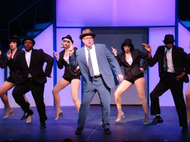 Steve Antonesen (center) as Carl Hanratty and the ensemble of Catch Me If You Can