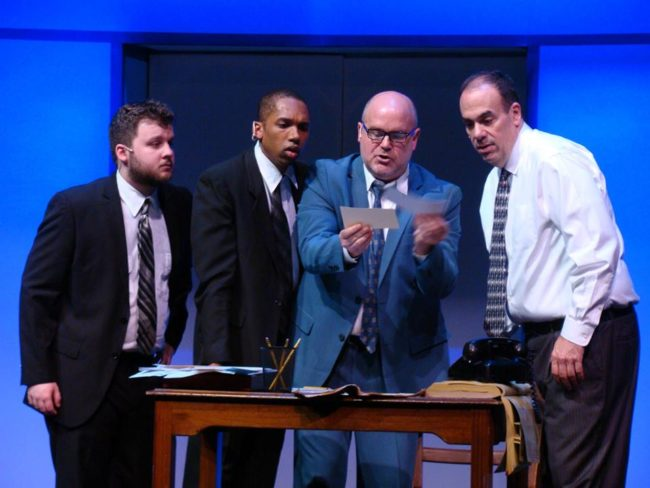 (L to R) Zach Husak as Agent Cod, Derek Cooper as Agent Dollar, Steve Antonsen as Carl Hanratty, and Roger Schulman as Agent Branton