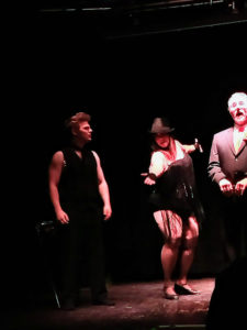 Scruffy Westside (left) with Tapitha Kix (center) and Dirk Hamfist (right) as Billy Flynn