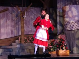 Jamie Griffith (left) as Wolf and Ruby Webb (right) as Little Red Ridinghood