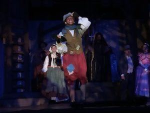 Tyler White (forward center) as Jack and Elizabeth Kenner (backward center) as Jack's Mother