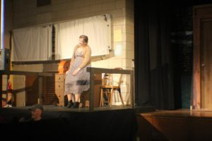 Director Heidi Toll as Miss Hannigan