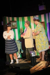 Valerie Ziegler (left) as Tracy Turnblad, Dylan Morrison (center) as Wilbur Turnblad, and Matthew Byrd (right) as Edna Turnblad