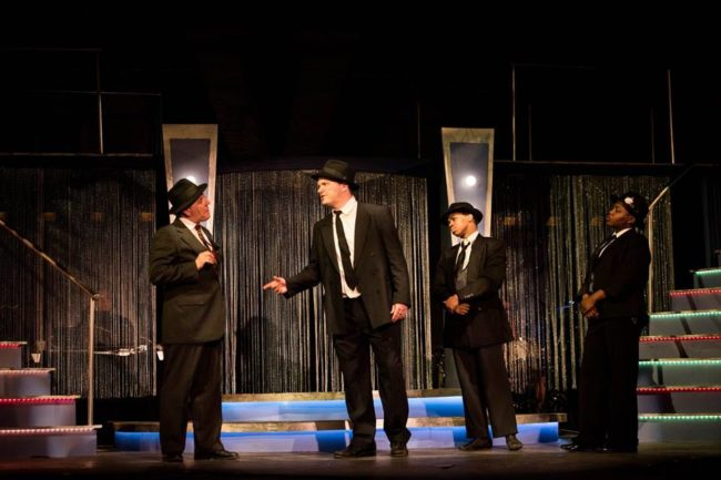 "Jerry Vess (left) as Nick Valenti and Jeffrey Hawkins (center) as Cheech discuss a ""contract"" in Bullets Over Broadway at Annapolis Summer Garden Theatre"