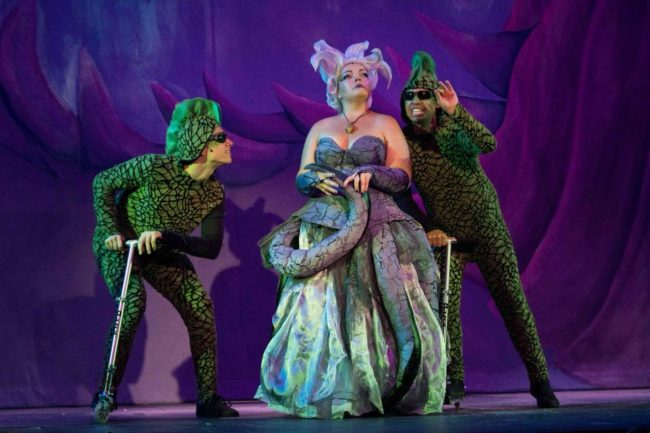 Josh Schoff (left) as Flotsam, Holly Gibbs (center) as Ursula, and Jonah Wolf (right) as Jetsam in The Little Mermaid