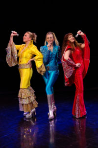 Coby Kay Callahan (left) as Tanya, Heather Marie Beck (center) as Donna Sheridan, and Tess Rohan (right) as Rosie in Mamma Mia!