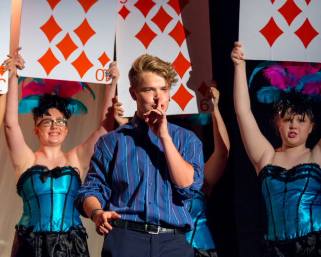 Nick Zuelsdorf (center) as Jack Singer and the ensemble of Honeymoon in Vegas
