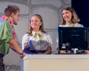 Nick Zuelsdorf (left) as Jack Singer with Sarah Gonder (center) and Sophie Talbert (right) as Ticket Agents