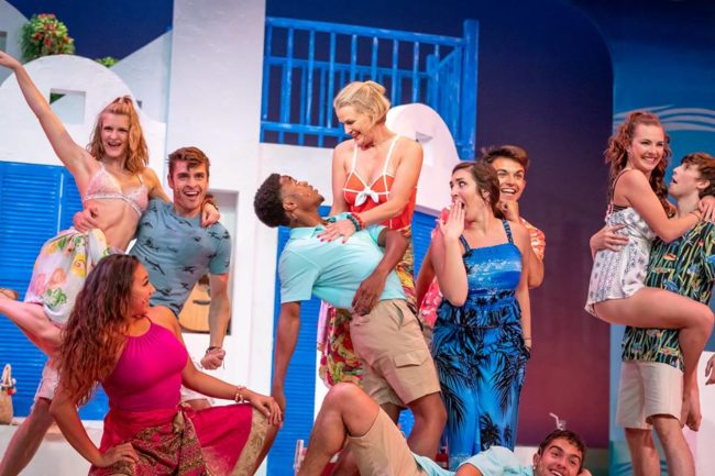 Dorian Davis (center left) as Pepper and Libbby Ingham (center right) as Tanya and the ensemble of Mamma Mia!