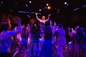 Heather Marie Beck (center) as Donna Sheridan and the company of Mamma Mia!