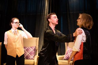 Broinninn Cummins (left) as Curio, Ian Cripe (center) as Duke Orsino, and Karis Schollenberger (righ) as Valentine
