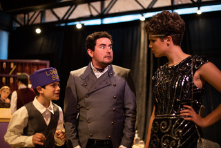 Andrew Ball (left) as Malvolio's Sidekick, Alex Foley (center) as Malvolio, and Audrey Kawecki (right) as Olivia