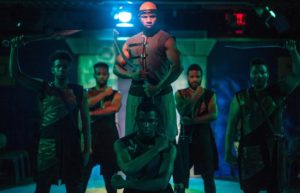 Jo'Nathan Michael (center) as Captain Radames and the ensemble of Aida at ArtsCentric