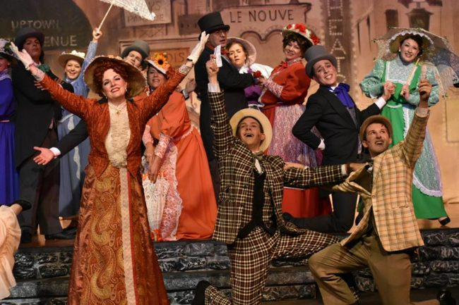 Dawn O'Croinon (front left) as Dolly Levi, Stephen Strosnider (front center) as Cornelius Hackl, and Mark Quackenbush (front right) as Barnaby Tucker in Hello, Dolly!