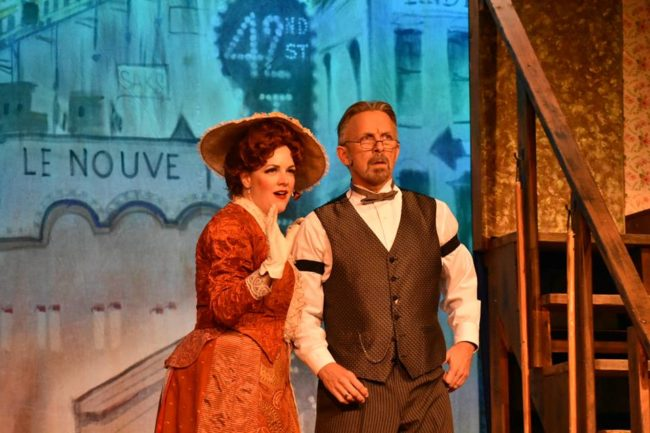 Dawn O'Croinin (left) as Dolly Levi and Homero Bayarena (right) as Horace Vandergelder in Hello, Dolly!