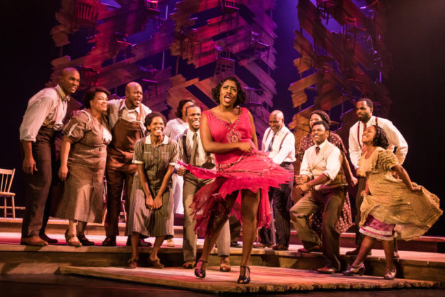 Carla R. Stewart (center) as Shug Avery and the ensemble of the national tour of The Color Purple